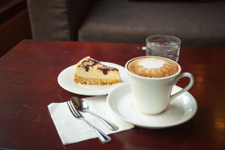 cappucino cup with cheese cake photo