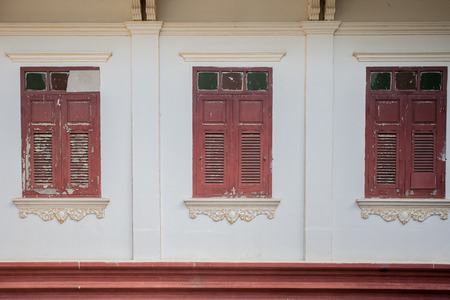 Traditional Thai style red old window on white wall photo