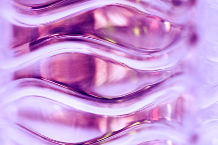 stack of water bottles - pink tone photo