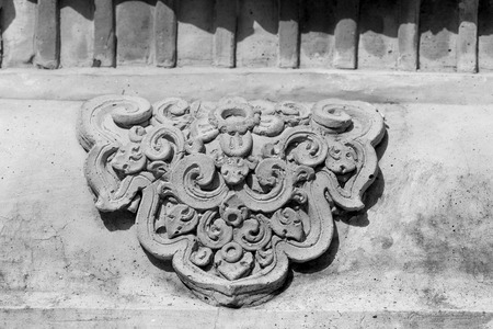The White stucco and thai style on the Wall photo