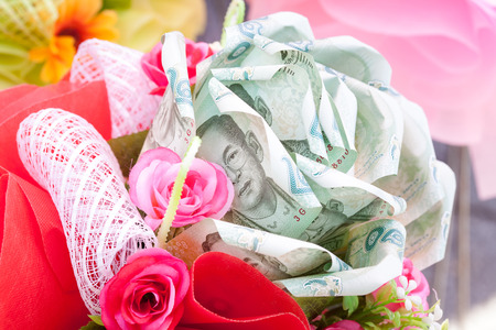 bath gown: Bouquet of flowers in white background made from currency baht a popular gift in Thailand. For congratulated the graduates