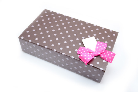brown box: brown box with gifts and pink bow