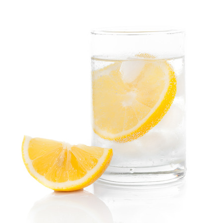 a glass of fresh drinking water and a lime