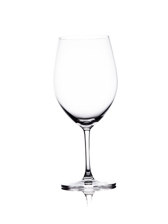 Empty glass of wine standing isolated on the white background Stock Photo