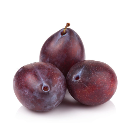 prune: ripe prune or plum isolated on a white background. Stock Photo