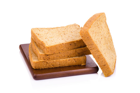 whole wheat bread: Slice of a whole wheat bread isolated on a white background