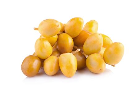 unripened: yellow raw dates isolated on white background