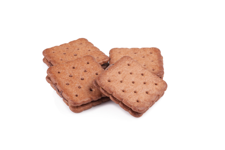 biscuts: Sandwich biscuits, filled with chocolate, isolated on white background