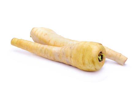 parsnip: Fresh parsnip roots on a white background Stock Photo