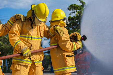 Firefighter fighting For A Fire Attack Stock Photo