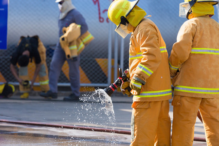 firefighter: Firefighter fighting For A Fire Attack Stock Photo