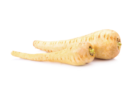 parsnip: Fresh parsnip roots on a white background. Stock Photo