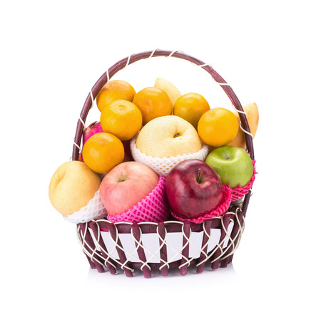 c vitamin: Fresh fruit in the basket against a white background.