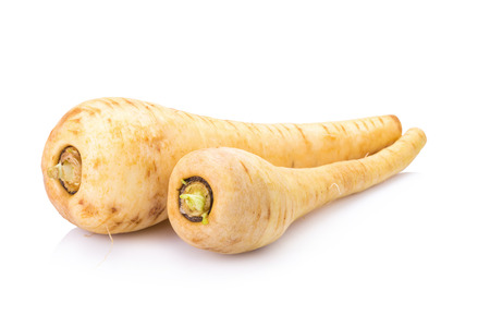 Fresh parsnip roots on a white background. Archivio Fotografico