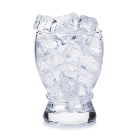 Glass of ice cubes on white background.