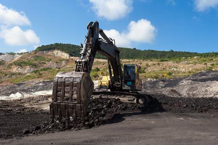 stacker: yellow backhoe work in coalmine