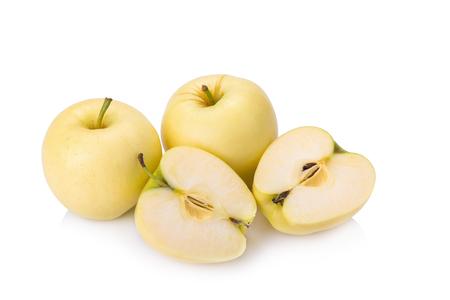 medium close up: ripe yellow apple isolated on white.