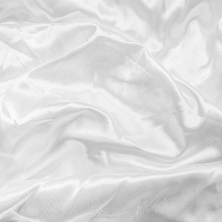 white satin: Abstract texture of white satin fabric.