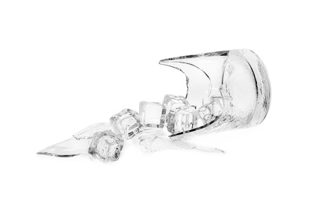 Broken glass and ice isolated on white.