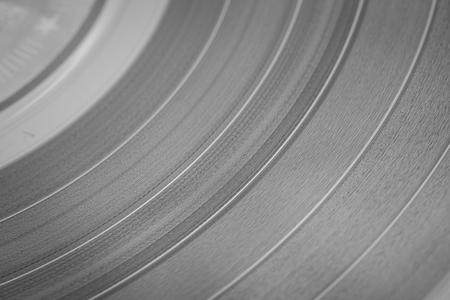 bakelite: Vinyl disc close-up.
