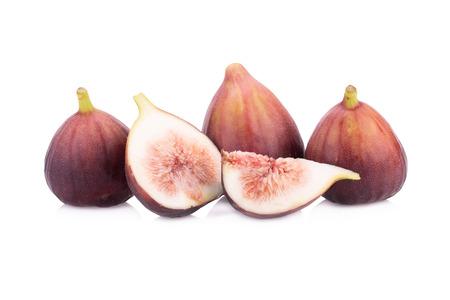 sweet segments: Fresh figs isolated on white background.