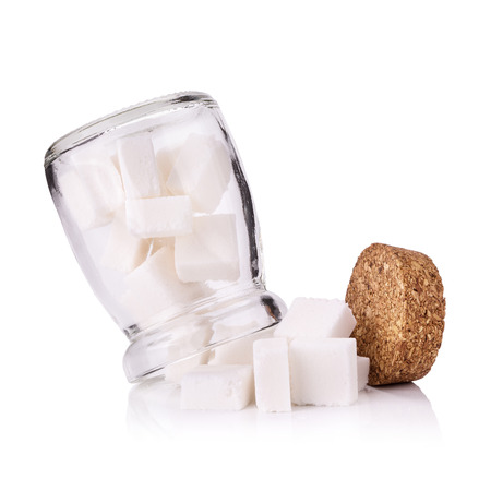 sweetening: Sugar cubes in a glass bottle. Stock Photo