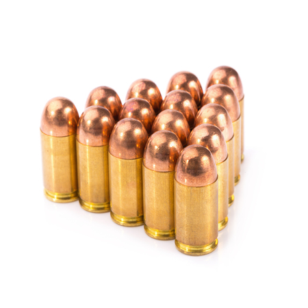 full metal jacket: 9mm bullet for a gun isolated on white background.