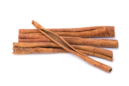 white backing: Cinnamon sticks isolated on white background. Stock Photo