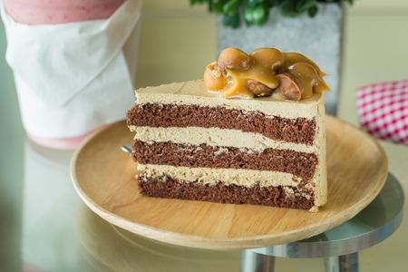 savory: Macadamia cake on wooden plate.