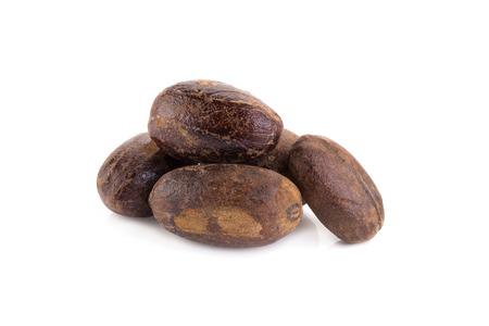 Nutmeg isolated on white background. Stock Photo