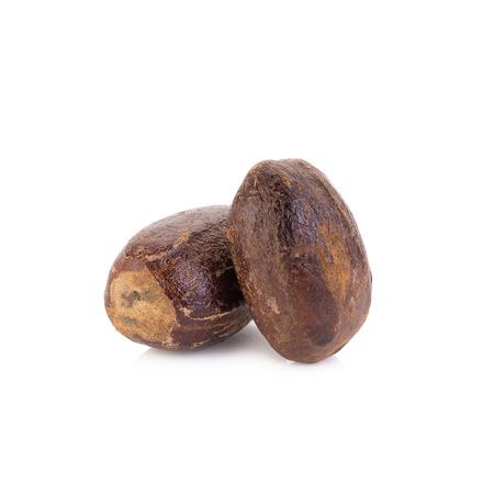 nutmeg: Nutmeg isolated on white background. Stock Photo