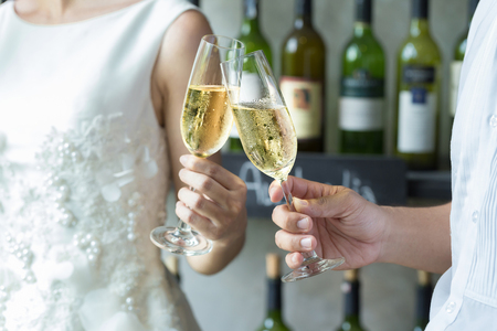 People holding glasses of champagne making a toast. Stock Photo