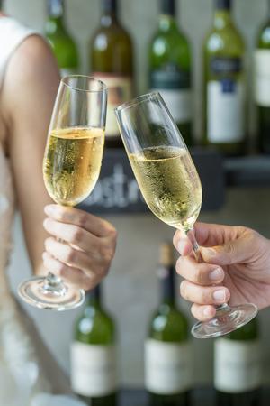 People holding glasses of champagne making a toast. Reklamní fotografie