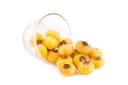 ebenaceae: Gold Apple, Diospyros decandra Lour. Thai fruit and Thai herb in glass bowl.