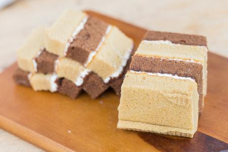 refreshment: Chocolate chiffon cake on wooden background. Stock Photo