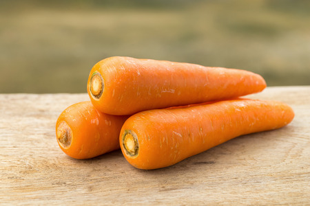 carrot on wooden background. Stock Photo