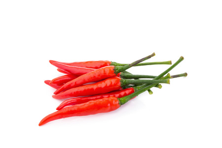 capsaicin: Red chili pepper on white background. Stock Photo