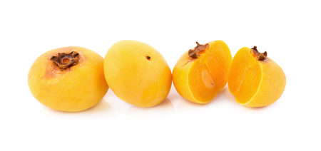 ebenaceae: Gold Apple, Diospyros decandra Lour. Thai fruit and Thai herb on white background. Stock Photo