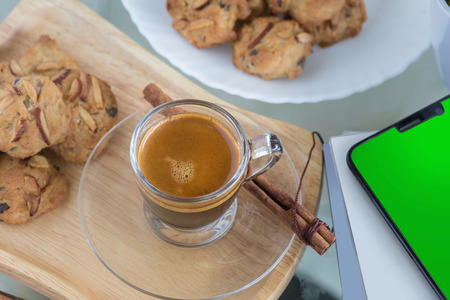 Almond flavored Cookies and Cup of espresso coffee. Stock Photo