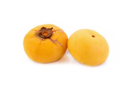 diospyros: Gold Apple, Diospyros decandra Lour. Thai fruit and Thai herb on white background. Stock Photo
