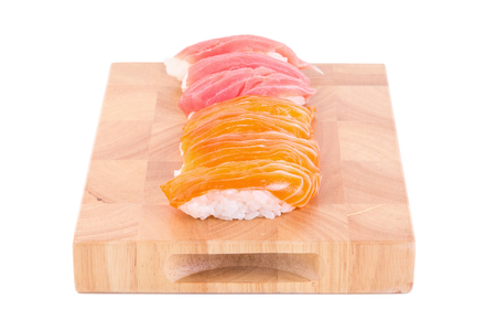 specialize: sushi on the wood plate on white background.