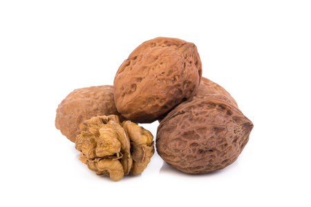 nutshells: walnut and a cracked walnut isolated on the white background. Stock Photo
