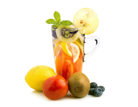 Detox water with fruit in glasses isolated on a white background.