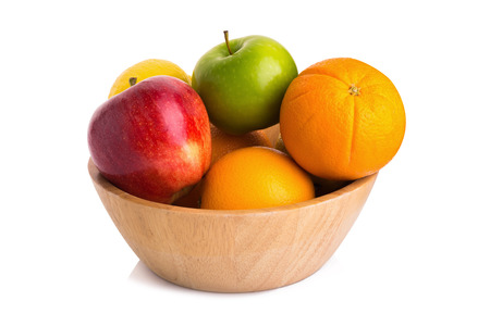 nonfat: wooden bowl with fruits isolated on white.