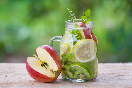 Detox water with kiwi ,lemon and red apple. Stock Photo