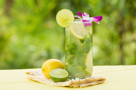 Detox water with lemon on rustic wooden background