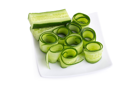 Cucumber and slices isolated on white background. Stock Photo