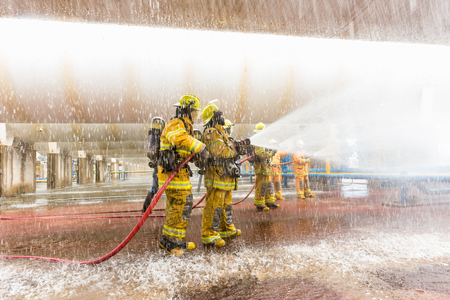 Firefighters training, foreground is drop of water springer, Selective focus