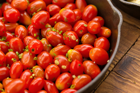 Stir fried sweet tomato cherry on pan