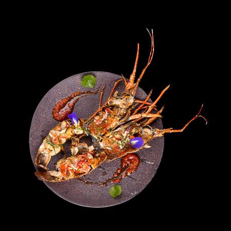 Barbeque lobster on black background.